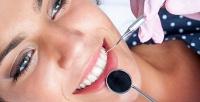 Лечение кариеса иУЗ-чистка зубов для одного или двоих встоматологии «Омега-Дент». <b>Скидкадо86%</b>