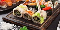 Роллы, суши инаборы отслужбы доставки Wasabi соскидкой50%