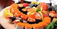 Роллы, суши инаборы без ограничения суммы чека отслужбы доставки Yoshi-Sushi27со скидкой50%