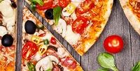 Всё меню пиццы без ограничения суммы чека отмикс-кафе «Снедин» соскидкой50%