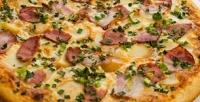 Все виды пиццы всемейном кафе «Донна» соскидкой50%