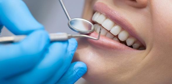 УЗ-чистка, лечение кариеса встоматологии Dental Center
