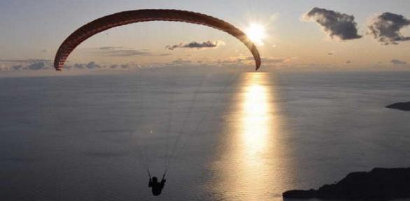 Полеты напараплане спляжа Финского залива откоманды Fly