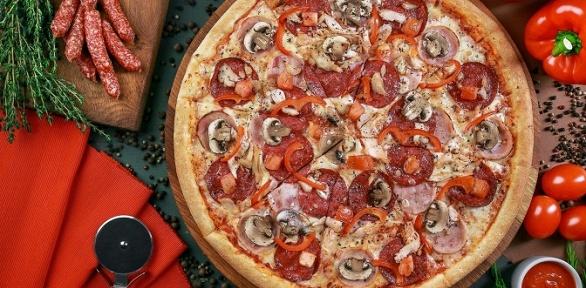 Пицца отпиццерии «ПиццаФабрика» заполцены
