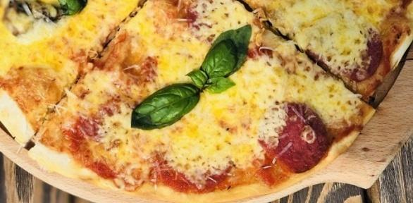 Пицца издровяной печи отресторана «Буфет» заполцены