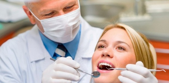 УЗ-чистка зубов, лечение кариеса вклинике ImplantDent