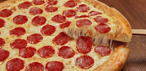 Пицца, закуски идесерты отDomino's Pizza заполцены